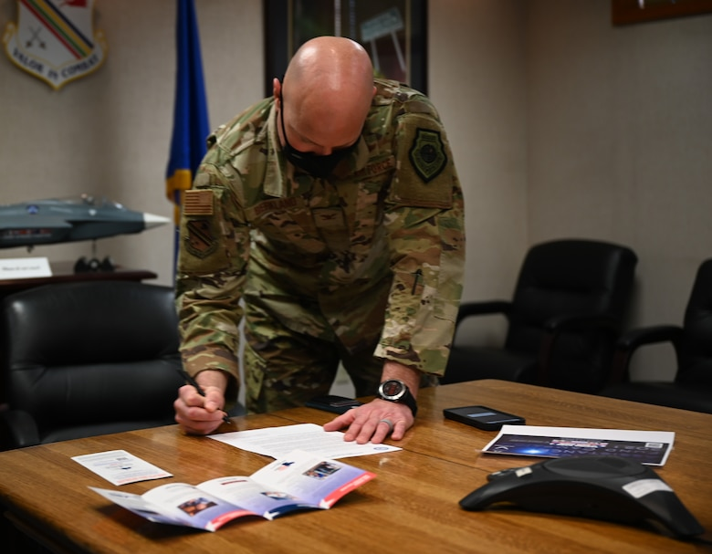 U.S. Air Force Col. David Berkland, the 354th Fighter Wing commander, signs the Air Force Assistance Fund (AFAF) campaign memorandum, on Eielson Air Force Base, Alaska, March 15, 2021.