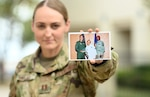 Capt. Illma Vallee, 12th Training Squadron flight commander, shows a picture of when she worked at Travis Air Force Base California, as an enlisted cook. Illma graduated from the U.S. Air Force Academy in 2013 and became a KC-135 pilot, she enjoys running marathons and mountaineering.  (U.S. Air Force photo by Benjamin Faske)
