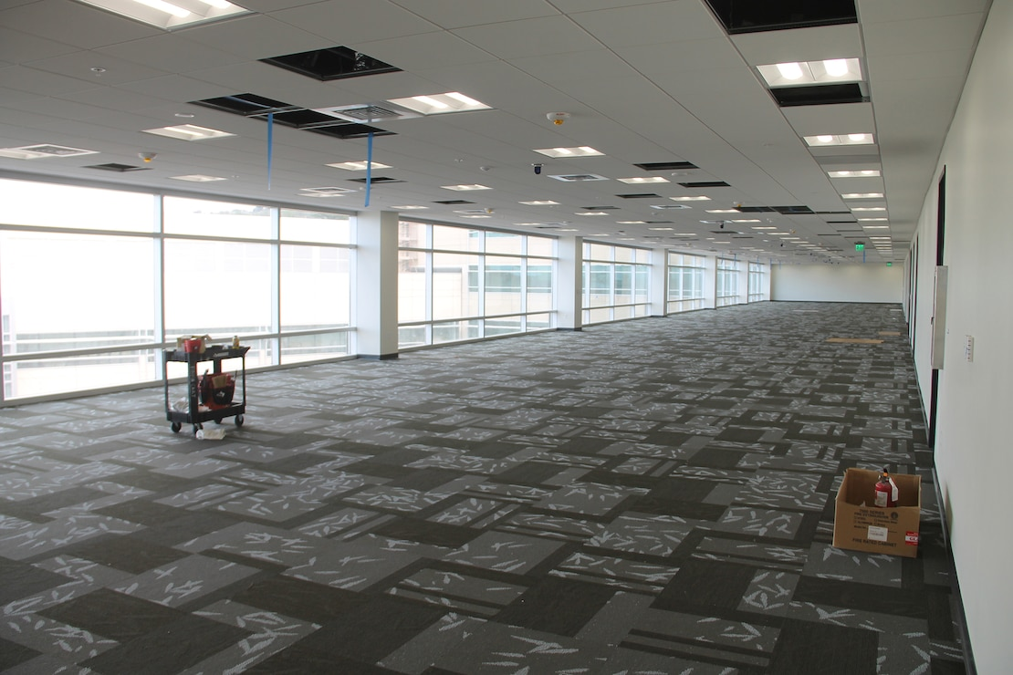 Flooring and ceiling fixture work is being finalized by the Honolulu District project team inside the U.S. Army Pacific's new Command and Control Facility at Fort Shafter.