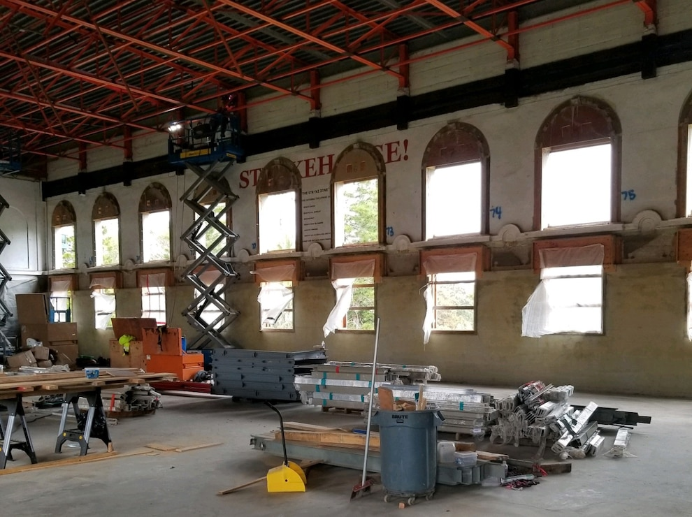 Renovations to the third floor gym area of Bldg. 155 include the ceiling support, resurfacing of walls, floors, and force protection level windows.