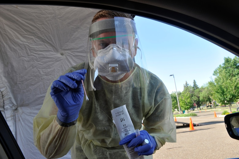 Spc. Collin Ahmann, North Dakota Army National Guard Medical Detachment, prepares to collect a COVID-19 test specimen at the North Dakota state capitol in Bismarck July 6, 2021. The Guard has supported the state's response to the pandemic since March 16, 2020.