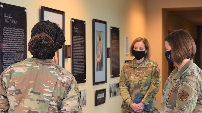 Chief Master Sergeant of the Air Force JoAnne S. Bass, right, tours the Office of Special Investigations Hall of Heroes during her inaugural visit as CMSAF to OSI Headquarters, Quantico, Va., March 12. Guiding the Hall tour is Tech. Sgt. Trakeila Holt, left, and OSI Command Chief Master Sgt. Karen Beirne-Flint. (Photo by SA Spencer King)