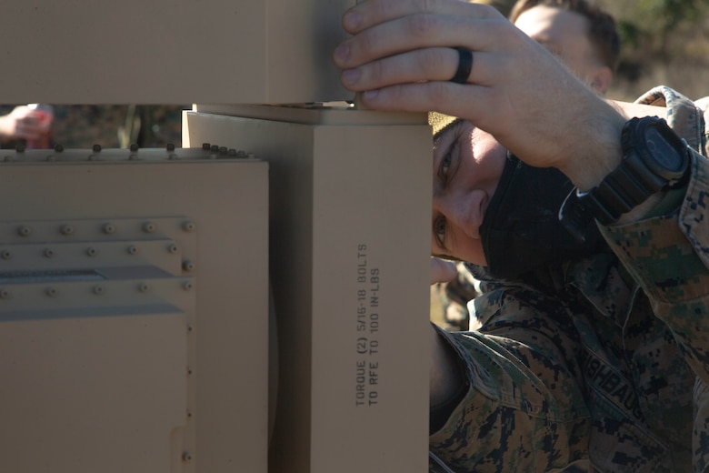 A marine looks at the camera during the  2nd Intelligence Battalion Field Exercise.