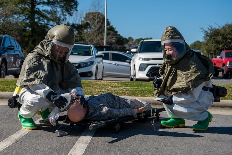 4th Medical Group Airmen participate in chemical decon training.