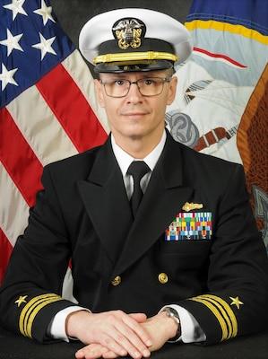 """Official portrait of Lt. Cmdr. Robert """"Jake"""" Bebber."""