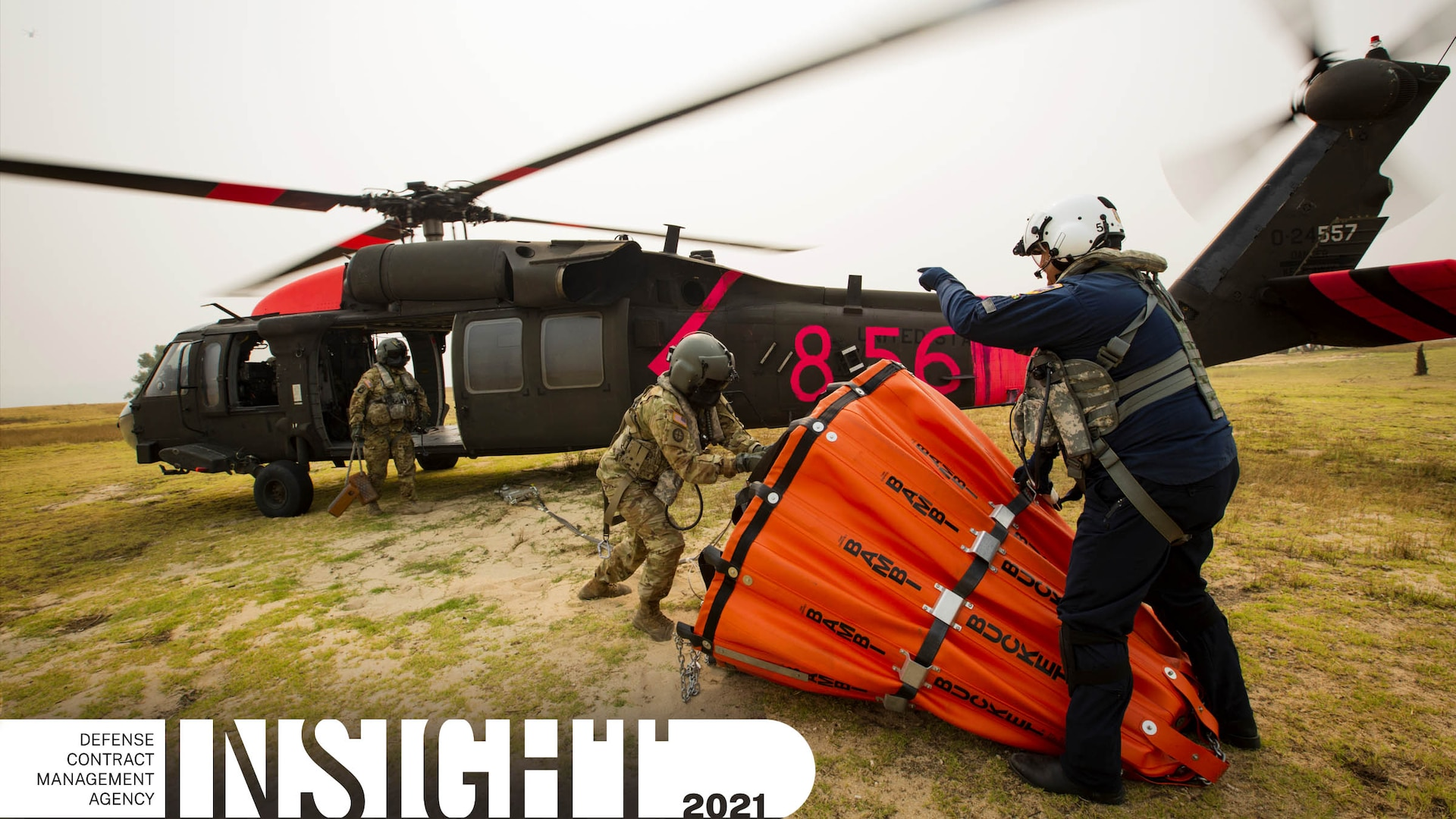 Three UH-60 Black Hawk helicopter crew members conduct training.