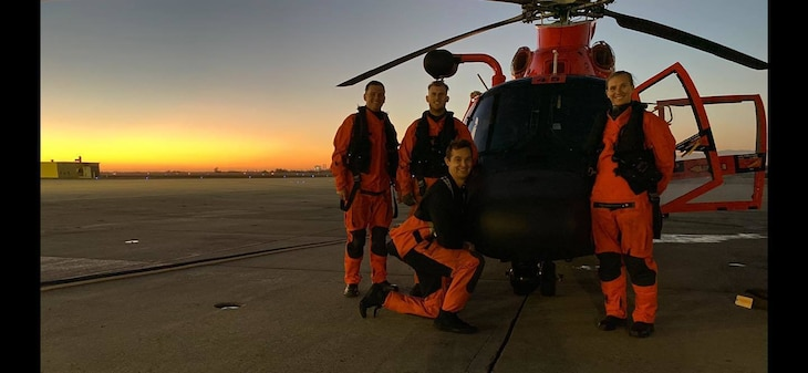 Lt. Mitchell Dow, Lt. Kristin Euchler, Petty Officer 2nd Class Thomas Cheuvront, and Chief Petty Officer Michael VonBormann take a group photograph after successfully medevacing an injured crewman from a commercial cargo ship more than 46 miles west of San Luis Obispo, Feb. 19, 2021.