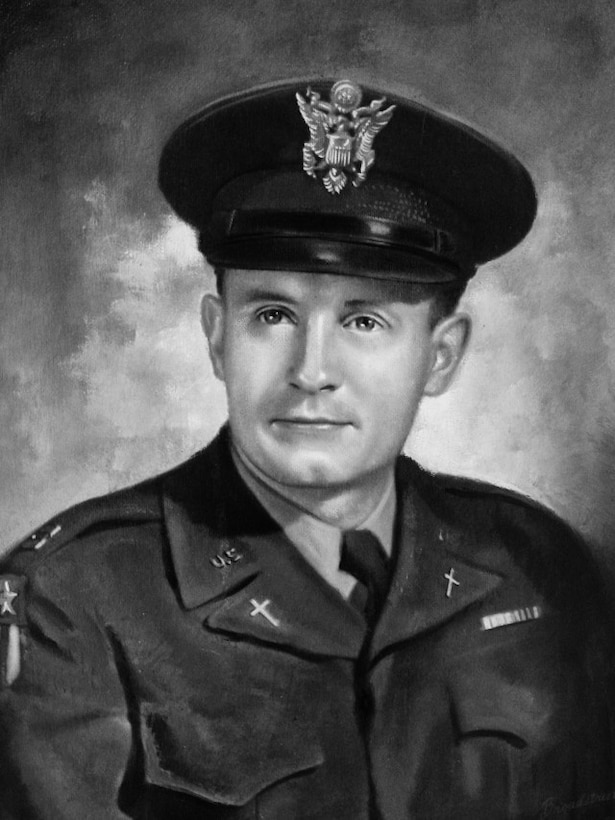 A man in a military uniform and cap poses for a photo.