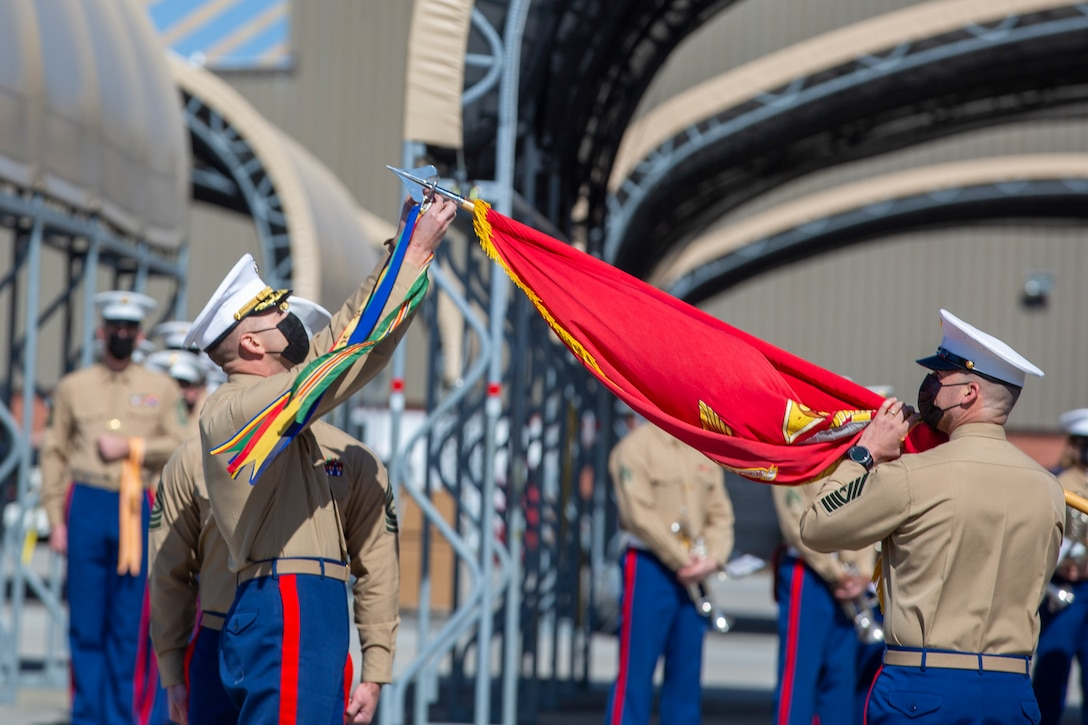 U.S. Marine Corps Lt. Col. Trevor Felter, attaches campaign streamers to his squadron's colors during a ceremony at Marine Corps Air Station Cherry Point, North Carolina, March 5, 2021. The Marines of Marine Attack Squadron (VMA) 542 celebrated the 77th anniversary of their squadron being formed with a ceremony that focused on the squadron's history as well as rededicating each Marine to service to the United States. VMA-542 was established during World War 2 and has seen service in each major conflict the United States has taken part in to include counter-insurgency operations in Iraq and Afghanistan and more recently against ISIS. The squadron will be deactivated in fiscal year 2022 as part of the Marine Corps' force redesign plan. Felter is the commanding officer of VMA-542. VMA-542 is a subordinate unit of 2nd Marine Aircraft Wing, which is the aviation combat element of II Marine Expeditionary Force. (U.S. Marine Corps photo by Lance Cpl. Yuritzy Gomez)