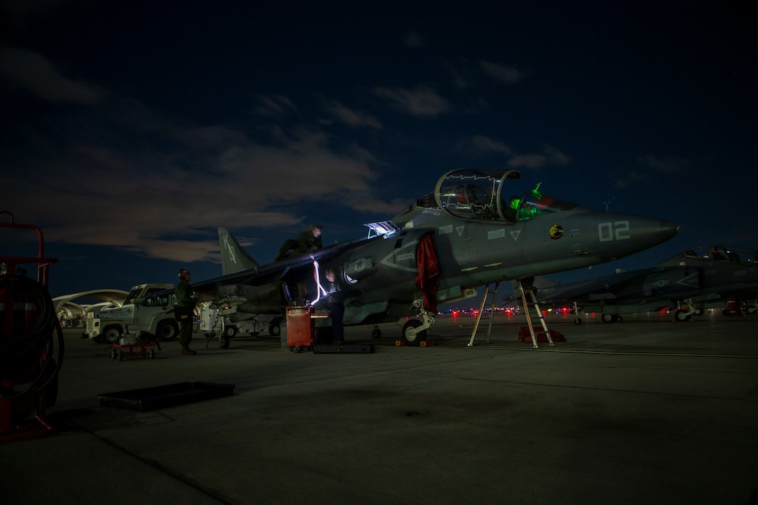 Marines perform nightly checks of the AV-8B Harrier II at Marine Corps Air Station Yuma, Arizona, Jan. 25, 2021. Marines with Marine Attack Training Squadron 203 (VMAT-203) trained with ordnance in an unfamiliar environment in order to increase proficiency in critical mission skills such as low altitude tactics, complex maneuvers, and close air support. VMAT-203 is a subordinate unit of 2nd Marine Aircraft Wing, the air combat element of II Marine Expeditionary Force. (U.S. Marine Corps Photo by Sgt. Servante R. Coba)