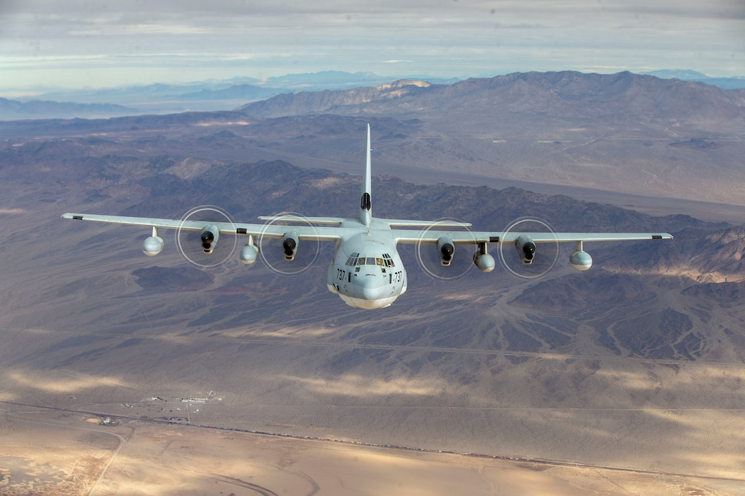 A KC-130J Super Hercules flies over Marine Corps Air Ground Combat Center, Twentynine Palms, California, Feb. 2, 2021. Marines with Marine Aerial Refueler Transport Squadron 252 (VMGR-252) trained in an unfamiliar environment in order to increase proficiency in critical mission skills such as aerial refueling, complex maneuvers, and logistical support. VMGR-252 is a subordinate unit of 2nd Marine Aircraft Wing, which is the aviation combat element of II Marine Expeditionary Force. (U.S. Marine Corps photo by Sgt. Servante R. Coba)