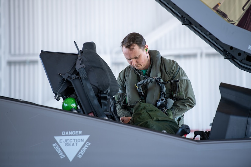 """Maj. Howard """"Cash"""" Shaner, F-35A Lightning II pilot assigned to the 134th Fighter Squadron, Vermont Air National Guard, exits an F-35 at the Vermont Air National Guard base, South Burlington, Vermont, March 12, 2021. Shaner is the first ever Air National Guard F-35 pilot to graduate from the highly competitive U.S. Air Force Weapons School. (U.S. Air National Guard photo by Mrs. Julie M. Paroline)"""