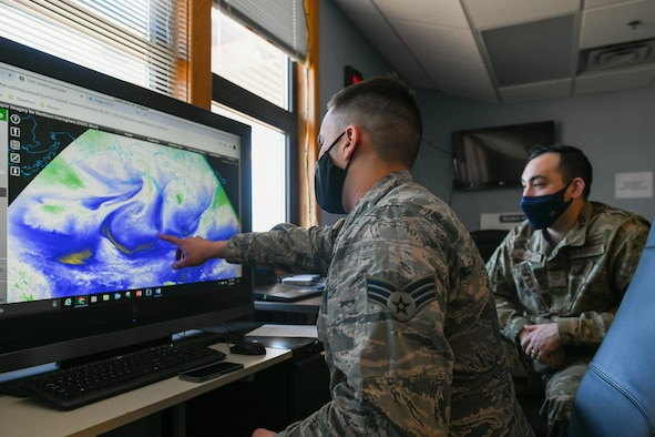 Senior Airman Jonah Reeves, 22nd Operations Support Squadron weather forecaster, discuses water vapor bands March 3, 2021, at McConnell Air Force Base, Kansas. The system is effectively utilized for identifying large scale patterns in the upper troposphere, jet streams and regions where the potential for turbulence exists. (U.S. Air Force photo by Senior Airman Nilsa Garcia)