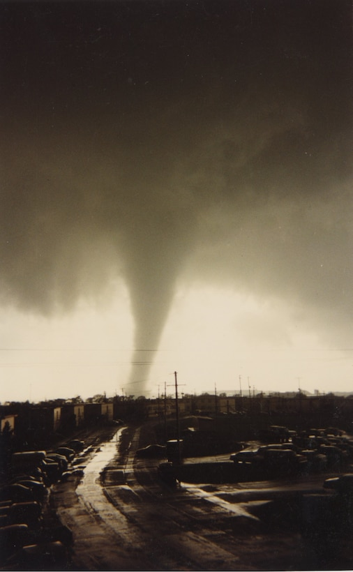 A tornado strikes military housing. April 16, 1991, at McConnell Air Force Base, Kansas. Over 100 housing units and nine major facilities were destroyed and damaged by the tornado during the most severe storm season ever recorded in Kansas. (U.S. Air Force photo by Senior Airman Nilsa Garcia)