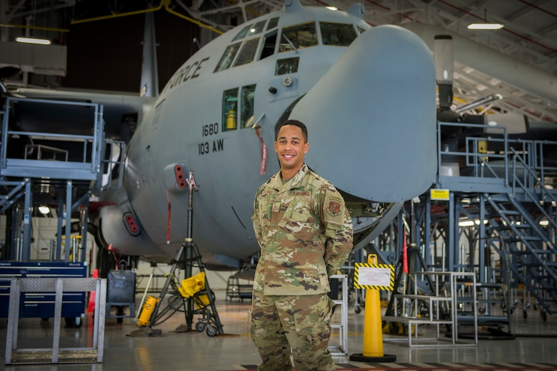 Senior Airman Jonathan Petersen, 103rd Maintenance Squadron electrical and environmental systems specialist, stands in front of a C-130H Hercules at Bradley Air National Guard Base in East Granby, Connecticut, March 16, 2021. Petersen attended U.S. Army Ranger School through the Air National Guard's Enlisted Development Opportunities program, and was the only Air National Guardsman in his graduating class, which completed the course Feb. 5. (U.S. Air National Guard photo by Staff Sgt. Steven Tucker)