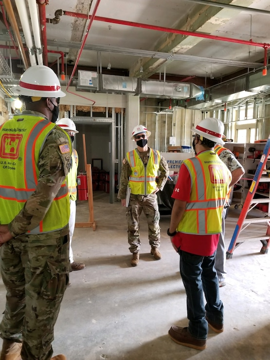 SCHOFIELD BARRACKS (Dec. 10, 2020) -- Honolulu District Commander Lt. Col.. Eric Marshall discusses construction progress with the District's Schofield Barracks Quad B Bldg. 155 renovation project team during
