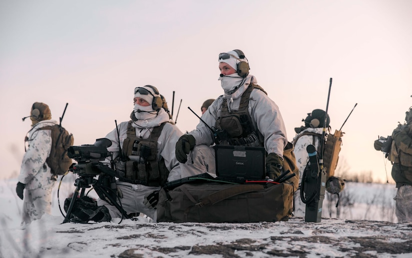 Troops operate in the snow.
