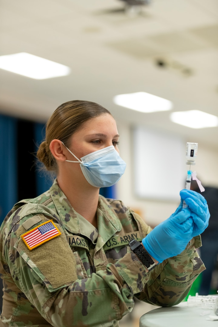 Members of the Oklahoma National Guard assist with COVID-19 vaccinations across the state. The Oklahoma National Guard continues working alongside Oklahoma State Department of Health partners throughout the state in the fight against COVID-19. (Oklahoma National Guard photo by Sgt. Jordan Sivayavirojna)