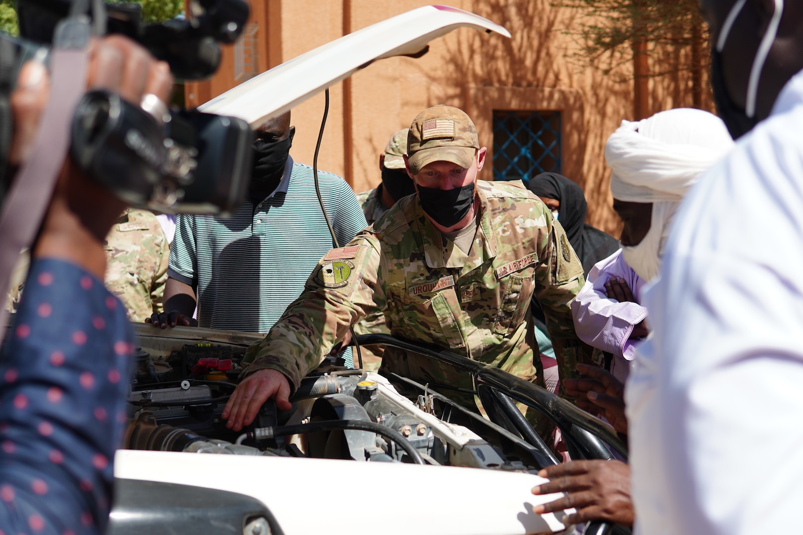 U.S. Air Force Staff Sgt. Jeffrey Urquhart, 724th Logistics Readiness Flight vehicle maintenance technician, briefs repairs that were made on an unserviceable ambulance to medical staff and media at the District Sanitaire Commune d'Agadez clinic in Agadez, Niger, Oct. 30, 2020.