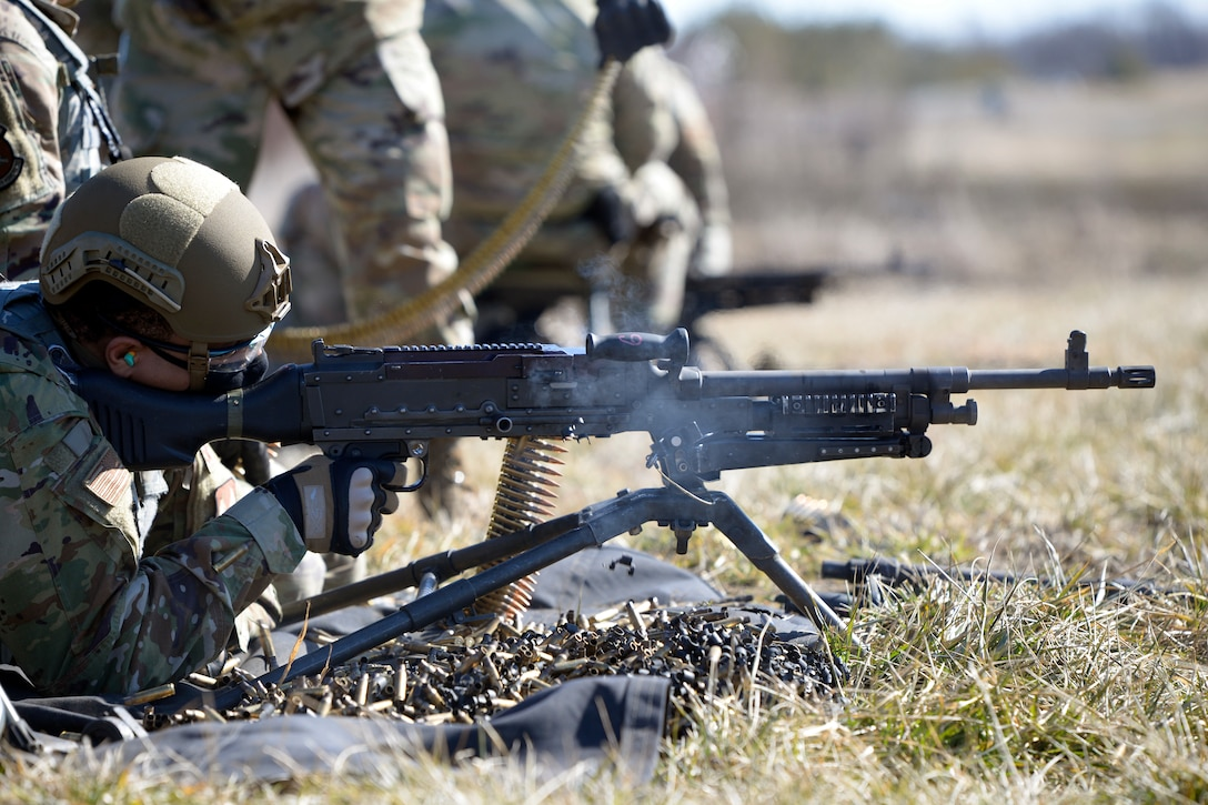 Airman 1st Class Aaron Edge, an 88th Security Forces Squadron defender, from Wright-Patterson Air Force Base, Ohio, fires an M240B machine gun at Camp Atterbury in Edinburgh, Indiana, on Feb. 25, 2021. Members of the 88th SFS, travel to Camp Atterbury multiple times each year for readiness and qualification training with deployers on machine guns and grenade launchers. (U.S. Air Force photo by Ty Greenlees)