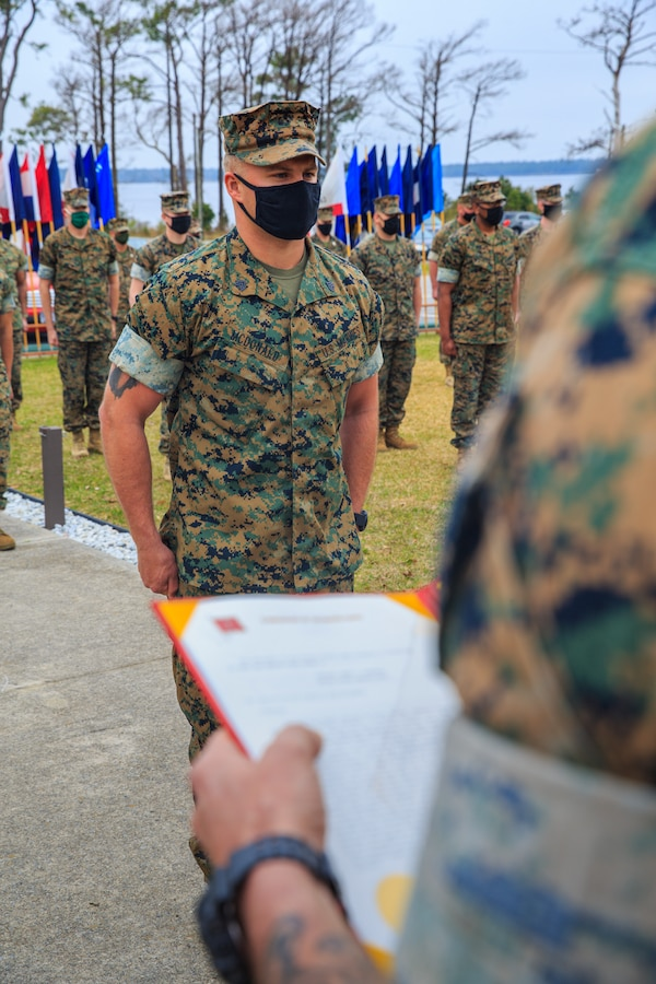 U.S. Marine Corps Sgt. Danny McDonald, scout sniper with 2d Battalion, 6th Marine Regiment, 2d Marine Division, is awarded the Navy and Marine Corps Medal at Camp Lejeune, N.C., March 17, 2021.