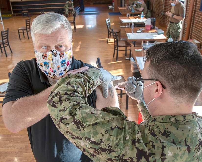 Dan Bell receives the first-of-two Moderna COVID-19 vaccine shots Feb. 10, 2021, in the former Samuel Adams Brewhouse on Naval Base Kitsap-Bremerton, in what is expected to be a phased employee vaccination process.