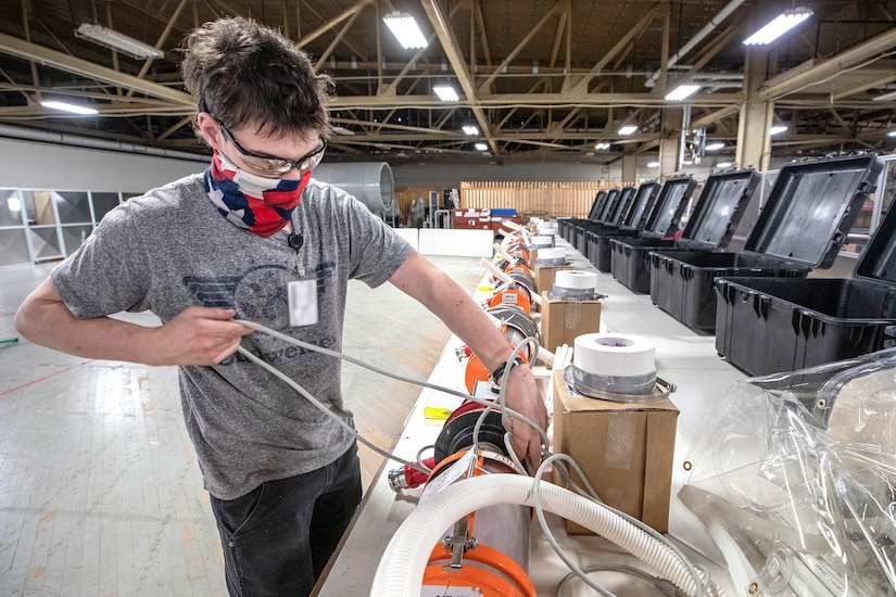 Gabe Morton, a work study employees with Shop 11, assembles Biocontainment System kits May 13, 2020, for use aboard U.S. Naval ships, that are being assembled in the Building 460 Sail Loft at Puget Sound Naval Shipyard & Intermediate Maintenance Facility in Bremerton, Washington.