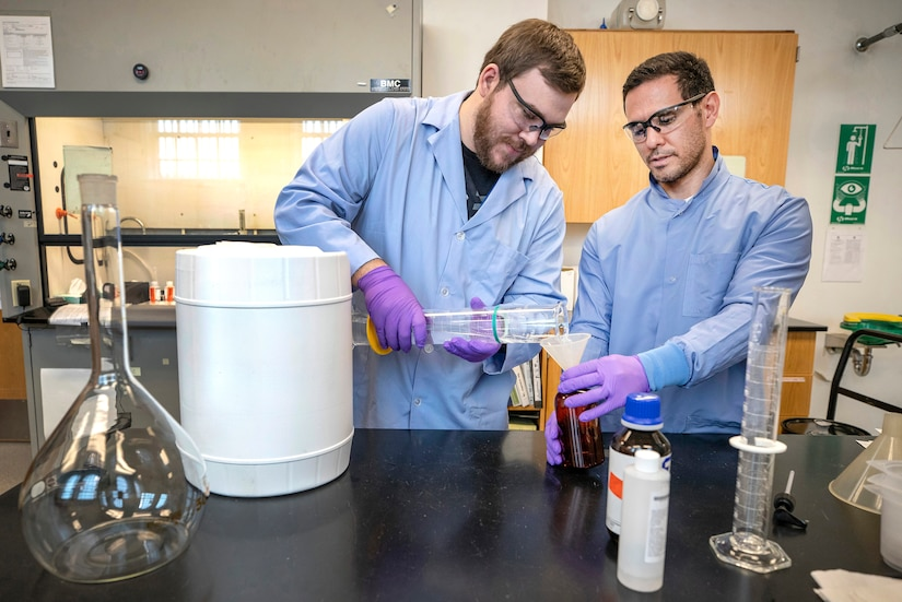 Anthony Painter, left, and Deniz Ferrin, both chemists, Code 130, Quality Assurance Office, make hand sanitizer March 20, 2020, in Building 59 at Puget Sound Naval Shipyard & Intermediate Maintenance Facility in Bremerton, Washington.