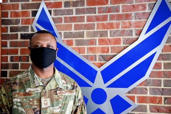 """Senior Master Sgt. Aaron Flanigan, specialist section chief, under the 932nd Maintenance Group's Aircraft Maintenance Squadron, pauses to reflect on what it means to be leading others as  an NCO, or noncommissioned officer, with the Air Force Reserve unit at Scott Air Force Base, Ill.  """"It means a lot to me.  It's an honor and a privilege to be able to lead Airmen.  You are helping to mold future leaders of the Air Force.  I don't take it lightly,"""" Flanigan said.  He's been with the unit for 12 years and hopes to improve the Air Force in the future by adding inputs.  """"I consider how to serve and observe.  I see where the needs are and any shortfalls, and look at how to improve it, not only with words, but in deeds as well.  I try to hit challenges head on and have a well-thought-out plan to meet those challenges,"""" he noted March 2, 2021. (U.S. Air Force photo by Lt. Col. Stan Paregien)"""