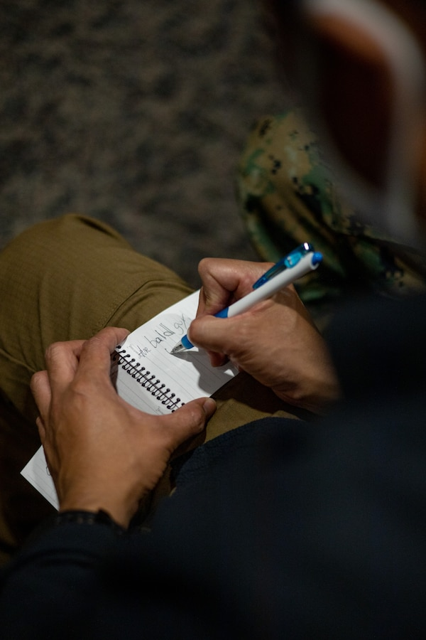 An Okinawa resident writes down English words during the English discussion class at the chapel on Marine Corps Air Station Futenma (MCAS), Okinawa, Japan, March 16, 2021. The Futenma Chapel English discussion provides U.S. Marines and Okinawa residents with an opportunity to learn each other's languages and share their cultures. The discussion is held every Tuesday at the MCAS Futenma Chapel at 6:30 p.m. (U.S. Marine Corps photo by Cpl. Terry Wong)