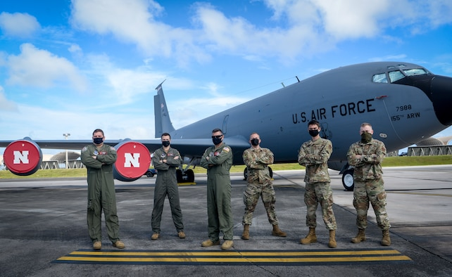 Five U.S. Air Force Guardsmen from the 155th Air Refueling Squadron, Nebraska Air National Guard, and one guardsman from the Alaska ANG, pose for a group photo on Andersen Air Force Base, Guam, Mar. 18, 2021.