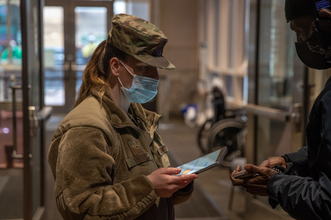 Pennsylvania National Guard Airman 1st Class Mackenzie Taylor registers a community member for a COVID-19 vaccine at the state-run, federally supported Center City Community Vaccination Center in the Pennsylvania Convention Center in Philadelphia March 17, 2021. Over 40 Soldiers and Airmen from the Pennsylvania National Guard are supporting the Department of Defense federal vaccine response operations.