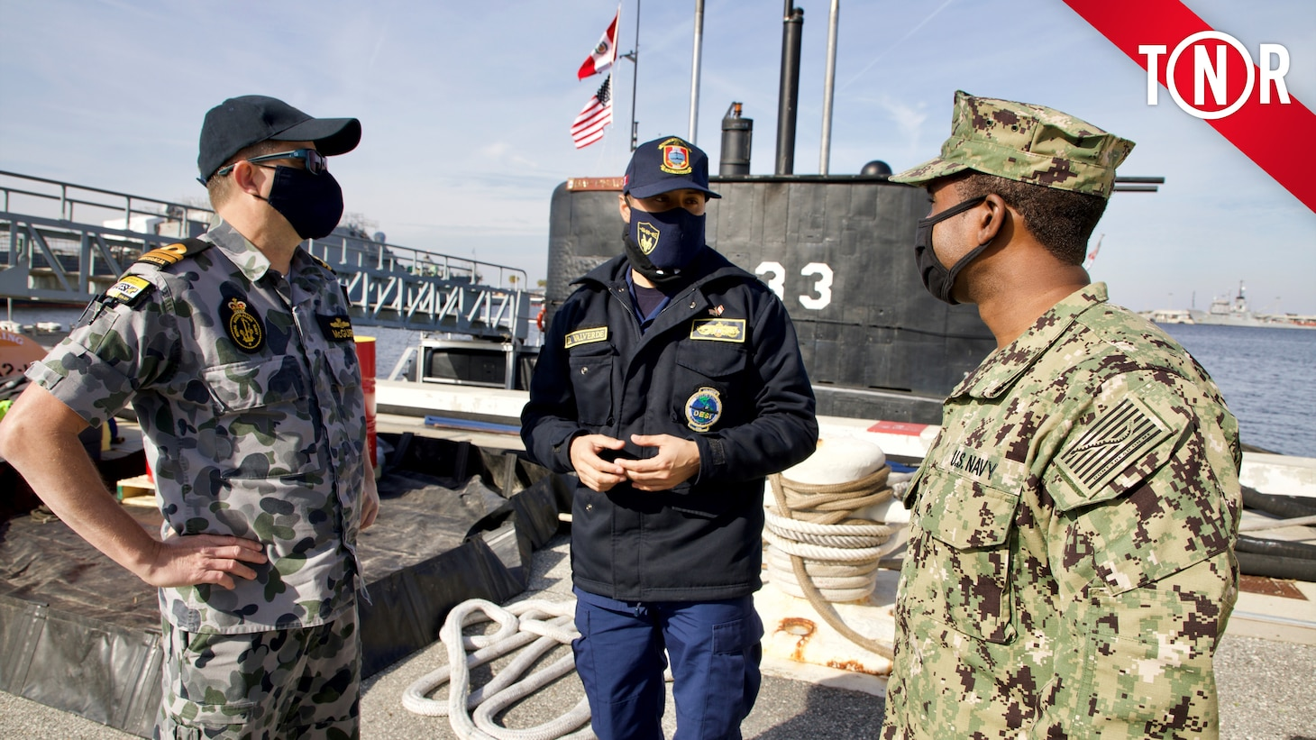 Lt. Matthew McGuire (RAN) and Lt. Reginald Caldwell speak with an officer from the Peruvian submarine BAP Pisagua (SS-33) at Naval Station Mayport. Pisagua is participating in exercises and training as part of the Diesel–Electric Submarine Initiative, now in its 20th year.