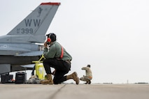 """Six 13th Fighter Squadron F-16 Fighting Falcons and a crew of 45 Airmen from various squadrons simulated a mock deployment to an """"austere"""" environment on the south ramp of the flightline. The designated location, which is not regularly used and not optimized for advanced operations, was utilized during a weeklong Agile Combat Employment (ACE) training exercise aimed at enhancing Multi-Capable Airmen's (MCA) skillset at Misawa Air Base, Japan, 15 through 19 March."""