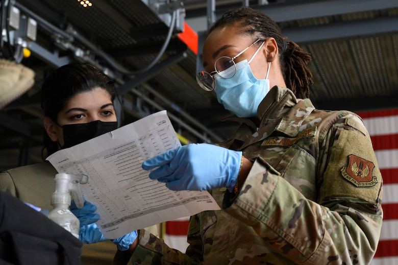 An Airman goes over a checklist with another Airman.