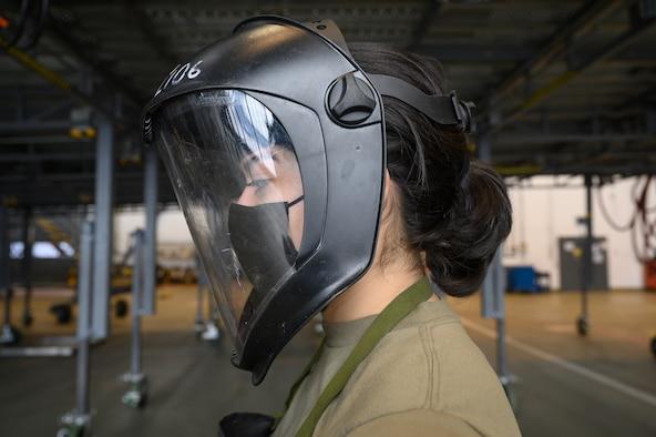 An Airman prepares for work.