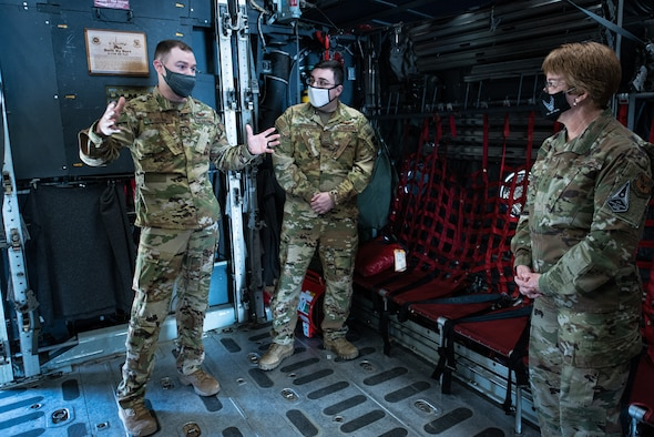 Three Airmen are briefed.