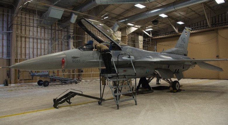 Members of the 849th Aircraft Maintenance Squadron work on the F-16 Viper Aircraft 9053, Feb. 23, 2021, on Holloman Air Force Base, New Mexico. The 849th AMXS spent 22 months rebuilding the aircraft to return it to operational status. (U.S. Air Force photo by Airman 1st Class Jessica Sanchez)