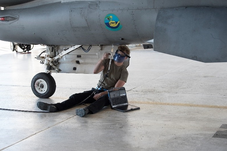Senior Airman Brian Raatz, 849th Aircraft Maintenance Squadron crew chief completes preflight ground checks on F-16 Viper Aircraft 9053, March 2, 2021, on Holloman Air Force Base, New Mexico. Aircraft maintainers perform pre, post and between-flight safety and function checks, which includes double and triple checking fluid levels, landing gear and flight control functionality and running diagnostics on the electrical systems. (U.S. Air Force photo by Airman 1st Class Jessica Sanchez)