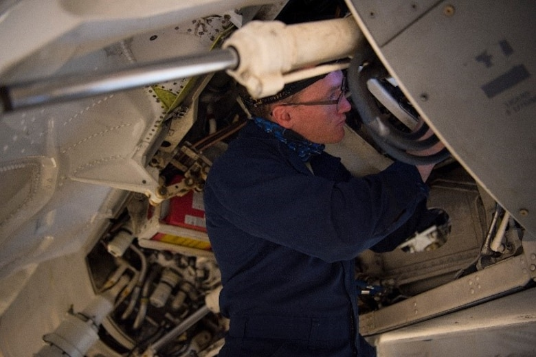 Staff Sgt. Bill Bohnas, 849th Aircraft Maintenance Squadron crew chief, tubes support brackets on hydraulic lines on an F-16 Viper, Feb. 23, 2021, on Holloman Air Force Base, New Mexico. The support brackets keep hydraulic lines from chaffing. (U.S. Air Force photo by Airman 1st Class Jessica Sanchez)