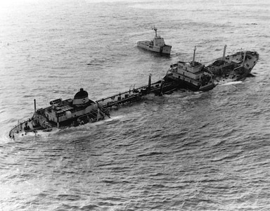 An aerial photo of the tanker Argo Merchant sinking off Nantucket Island in 1976.  USCGC Vigilant steams nearby.