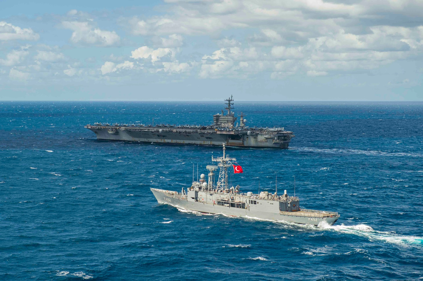210317-N-MD713-1007 MEDITERRANEAN SEA (March 17, 2021) The Turkish frigate TCG Gemlik (F 492), front, sails alongside the Nimitz-class aircraft carrier USS Dwight D. Eisenhower (CVN 69), in the Mediterranean Sea, March 17, 2021. The IKE Carrier Strike Group is on a scheduled deployment in the U.S. Sixth Fleet area of operations in support of U.S. national interests and security in Europe and Africa. (U.S. Navy photo by Mass Communication Specialist 3rd Class Cameron Pinske/Released)