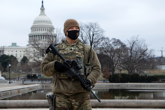 U.S. Army Spc. Kyle Moore with the 46th Military Police Company, 177th Military Police Brigade, Michigan National Guard, provides perimeter security near the U.S. Capitol in Washington, D.C., Feb. 12, 2021. The National Guard has been requested to continue supporting federal law enforcement agencies with security, communications, medical evacuation, logistics, and safety support to state, district and federal agencies through mid-March. (U.S. Army National Guard photo by Capt. Joe Legros)