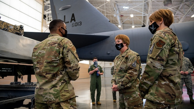Lt. Gen. Dorothy Hogg, U.S. Air Force Surgeon General, middle, and Chief Master Sgt. Dawn Kolczynski, Office of the Surgeon General medical enlisted force and enlisted corps chief, right, visit the 2nd Maintenance Group and speak with Airmen about their jobs and how they have handled the COVID-19 pandemic at Barksdale Air Force Base, Louisiana, March 10, 2021.