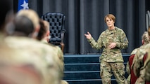 Chief Master Sgt. Dawn Kolczynski, Office of the Surgeon General medical enlisted force and enlisted corps chief, speaks during an all-call at Barksdale Air Force Base, Louisiana, March 10, 2021