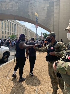 Members of the 372nd Military Police Battalion, District of Columbia Army National Guard, have positive interactions with protestors and other city pedestrians while assisting the D.C. Metropolitan Police Department at various metro stations June 6, 2020.