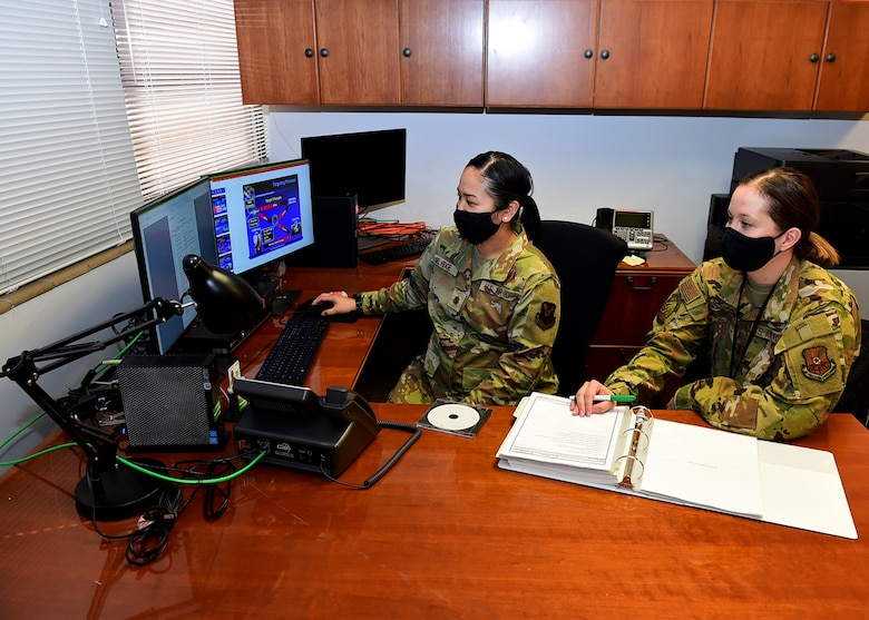 From left, Maj. Kristin Selvidge, 625th Strategic Operations Squadron planner, and Capt. Brittany Baver, 625 STOS planner, conduct targeting procedures for intercontinental ballistic missiles March 5, 2021, at Offutt Air Force Base, Neb.