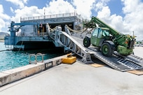 abees assigned to Naval Mobile Construction Battalion (NMCB) 4 load civil engineer support equipment (CESE) aboard the Spearhead-class expeditionary fast transport ship USNS Fall River (T-EPF-4) during a mount-out exercise (MOX) on board Naval Base Guam.