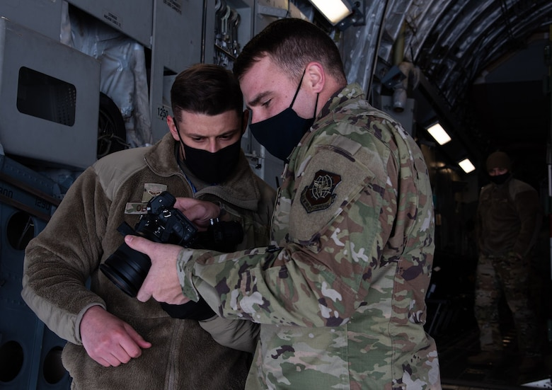 Airmen looks at camera.