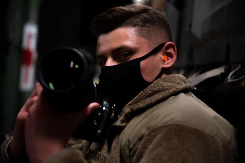 Airman looks at camera.